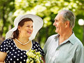Happy old couple with flower outdoor Royalty Free Stock Photo