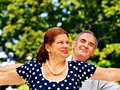 Happy old couple with flower outdoor Royalty Free Stock Photos