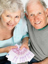 Happy old couple holding money - Top view Royalty Free Stock Photography