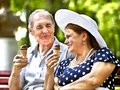 Happy old couple with ice-cream. Royalty Free Stock Photo