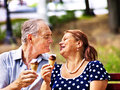 Happy old couple with ice cream eating outdoor Stock Photo
