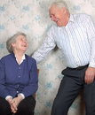 Happy old couple laugh until one cries Stock Photography