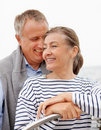 Happy old couple romancing while on a sea voyage Royalty Free Stock Image