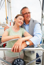 Happy old couple romancing while on a sea voyage Stock Photo