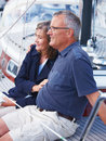 Happy old couple sitting on Yacht Stock Images