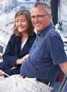 Happy old couple sitting on Yacht Royalty Free Stock Image