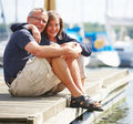 Happy old couple standing together at harbor Royalty Free Stock Photography