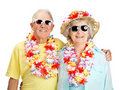 Happy old couple tourist wearing garland Stock Photos