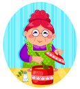 Happy old lady cooking soup Royalty Free Stock Image
