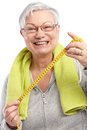 Happy old lady with tape measure Royalty Free Stock Photo