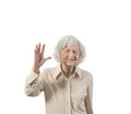 Happy old lady waving isolated with copyspace Stock Photos