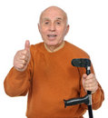 Happy old man holding crutch Royalty Free Stock Image