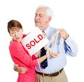 Happy old man hugging sad young woman closeup portrait of strange couple excited to have tying hands taking away girl holding sold Royalty Free Stock Photo