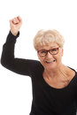Happy old woman having closed fists isolated on white Stock Photos