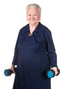 Happy old woman making fitness training with dumbbells Royalty Free Stock Photo