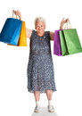 Happy old woman with shopping bags on a white background Stock Photo