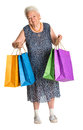 Happy old woman with shopping bags on a white background Stock Photography