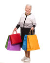 Happy old woman with shopping bags on a white background Royalty Free Stock Image