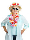 Happy old woman tourist wearing garland Stock Photos