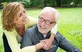 Happy older couple laughing outdoors close up portrait of a Royalty Free Stock Image