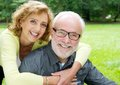 Happy older couple smiling and showing affection close up portrait of a Stock Photo