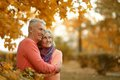 Happy older couple walking in the park Stock Photo