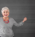 Happy older woman with gray hair smiling power Stock Photos