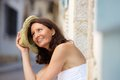 Happy older woman laughing with hat outside Royalty Free Stock Photo