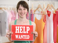 Happy owner of store with help wanted sign Royalty Free Stock Photo