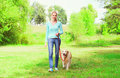 Happy owner woman with Golden Retriever dog is walking Royalty Free Stock Photo