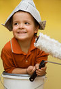 Happy painter with newspaper hat Stock Image