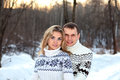 Happy pair in winter forest Royalty Free Stock Photo