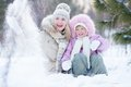 Happy parent and kid playing with snow in winter Royalty Free Stock Photo