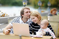 Happy parenthood concept young parents with their sweet baby girl in outdoors cafe Royalty Free Stock Photo