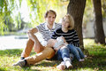 Happy parenthood concept young parents with their sweet baby girl in sunny park Stock Photography