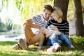 Happy parenthood young parents with their sweet baby girl in sunny park Stock Photo