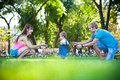 Happy parents with a baby in a greenl summer park Royalty Free Stock Photography