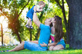 Happy parents with a baby in a greenl summer park Stock Image