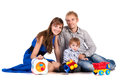 Happy parents with a baby in a studio. isolated Stock Photo