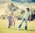 Happy parents with child playing with  ball Royalty Free Stock Photo