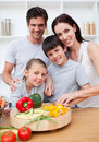 Happy parents cooking with their children Stock Image