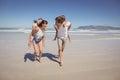 Happy parents piggybacking their children at beach Royalty Free Stock Photo