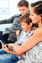 Happy parents with their son looking at touchpad pc together at home Royalty Free Stock Photos
