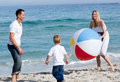 Happy parents and their son playing with a ball Royalty Free Stock Photo