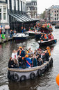 Happy people on boat at koninginnedag or queens day was a national holiday in the kingdom of the netherlands until celebrated Stock Photo