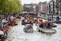 Happy people on boat at koninginnedag or queens day was a national holiday in the kingdom of the netherlands until celebrated Royalty Free Stock Image