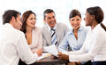 Happy people in a business meeting at the office smiling Royalty Free Stock Photography