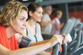 Happy people doing indoor biking in fitness club Royalty Free Stock Photo