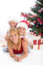 Happy people in front of christmas tree Stock Image