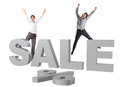 Happy people jumping behind big silver SALE sign Royalty Free Stock Photography